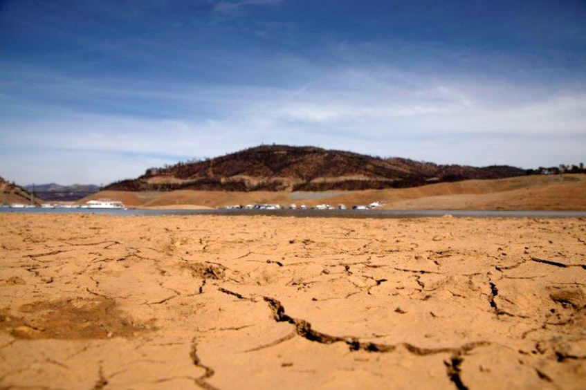 Dry land is visible last month at a section that is normally under water, on the banks of Lake Oroville, the second-largest reservoir in California. — REUTERS