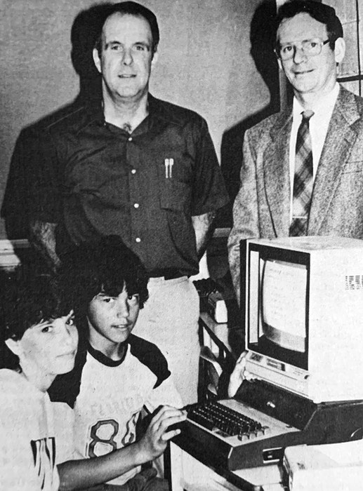 Students Theresa McGinn and Shawn Gallagher were eager to check out one of the two new Commodore 64 computers the Hantsport PTA purchased for the school in 1986. Also pictured were teacher David Stedman and PTA president Donald Hussey. - File Photo