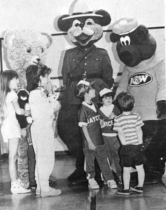 The 1986 Falmouth Teddy Bear Jamboree was reported to have been quite a success, drawing more than 1,000 visitors. Pictured here visiting Snuggles, the RCMP Safety Bear, and the A&W Bear were, from left, Allison Norris, Lisa Redden, J.J. Heffernan, Kate Heffernan and Colin Alexander. - File Photo