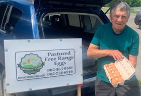 When Millcreek resident Alan Steele isn't collecting eggs from his laying hens at Sunrise Farm, he likes to spend time on the golf course. CONTRIBUTED