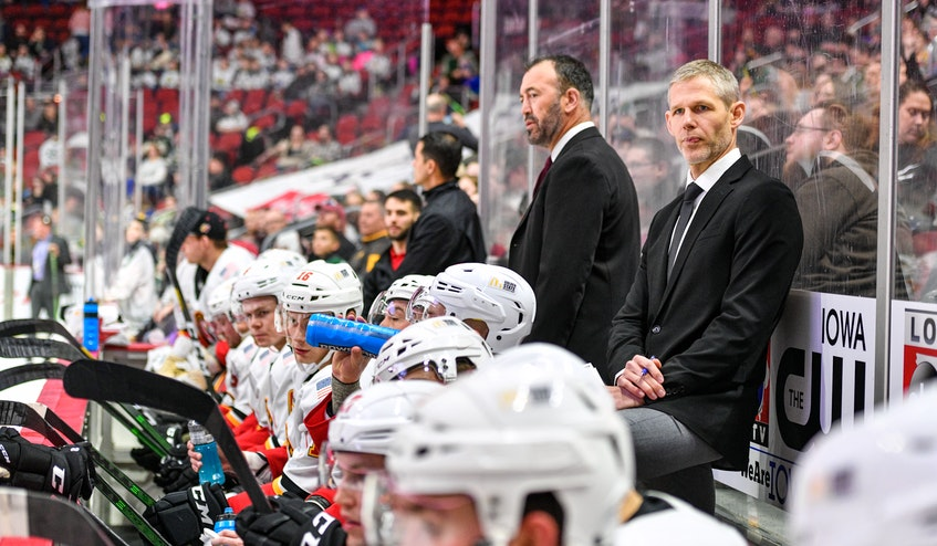 Cail MacLean watches the action during his time as the head coach of the AHL's Stockton Heat. - Calgary  Flames