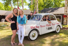 The MacKay family, shown with the prized family 'MacKay Motors Might Morris Minor' run the Car Life Museum. Family members shown, from left: Kristi, Shirlene, Greg and Kevin, who died in April 2020.