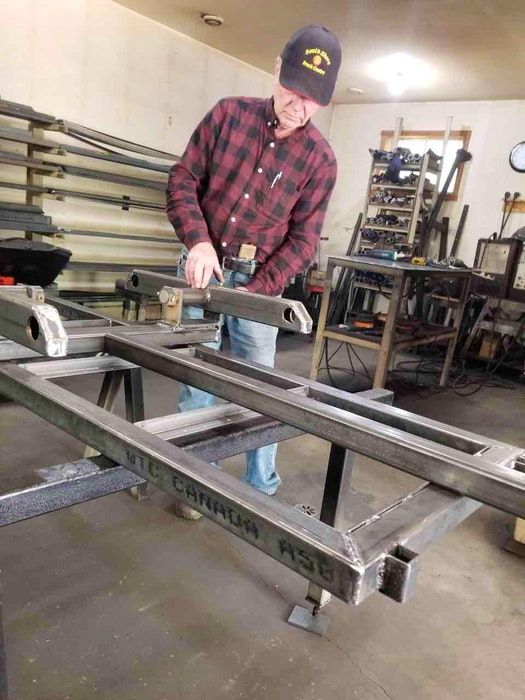 Allan Hubley building a walking beam for one of his trailers. - Marilyn Collie