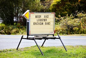 A roadside sign in Nova Scotia aptly described Atlantic Canadian appetite for local lobster and beer.