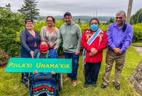 A delegation from We'koqma'q First Nation was on hand for the announcement of a new welcoming sign in Mi'kmaw to be erected in Port Hastings on Friday morning. Elder Ma'git Poulette holds a mockup of the sign with, from left to right, Nadine Bernard, Chief Annie Bernard-Daisley, Coun. Wallace Bernard, Coun. Tiny Cremoand Louie Joe Bernard. CONTRIBUTED