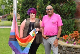 Truro Pride Society board member Melissa Howell and Truro Deputy Mayor Wayne Talbot raised the Progress Pride flag in Truro