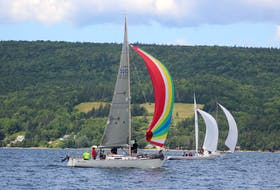 Keelboats participating the Ben Eoin Yacht Club and Marina's annual East Bay Regatta took full advantage of the favourable wind after changing heading and making their way back toward the marina. Above, the crew of Just in Time check out the billowed spinnaker as they swiftly sailed across the Bras d'Or Lake in Sunday's race that was sponsored by the The Lakes Resort and Golf Club. The three-day regatta began Friday and wrapped up Sunday. DAVID JALA/CAPE BRETON POST