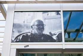 """Gerald Allen's photo is on display outside the Corner Brook Public Library as part of the PULP Gallery's """"Picturing Community"""" exhibition. The Corner Brook man died in October 2019 just after the photo was taken."""