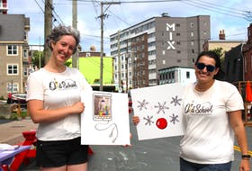 The goal of Old School Intergenerational Projects, started by Claire Rouleau (left) and Erin Winsor, is to create connections across ages through art. Here they show a matching game they had designed by local artist Katie Hayward, where people try to guess what piece of art corresponds with another.