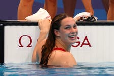 Penny Oleksiak of Canada celebrates after winning the silver medal in the Women's 4 x 100m Freestyle Relay, July 25, 2021. REUTERS/Kai Pfaffenbach