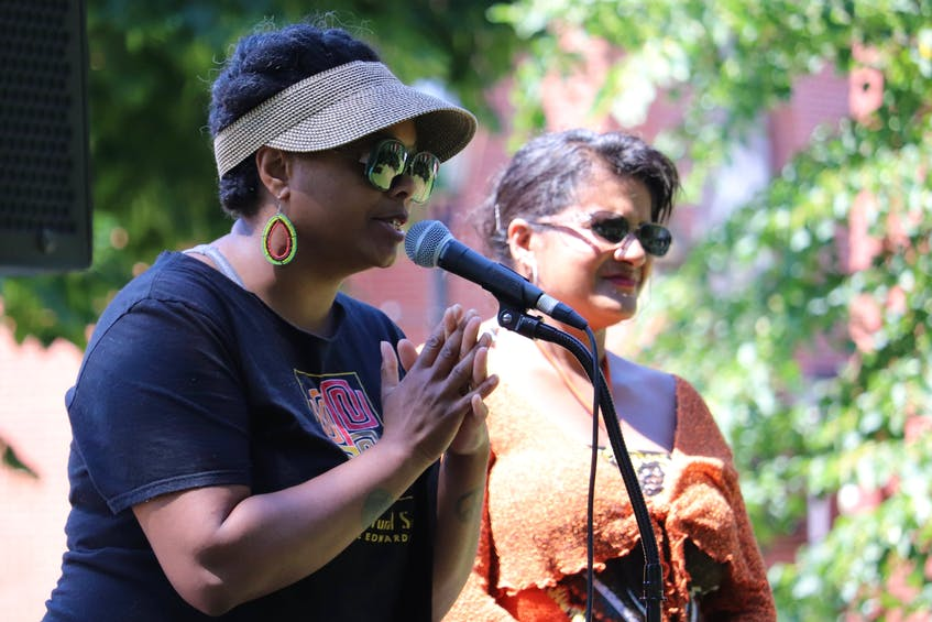 Tamara Steele, right, executive director of the Black Cultural Society, speaks about Emancipation Day on Aug. 1 in Charlottetown. Debbie Langston is on the right.  - Logan MacLean