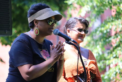 Tamara Steele, right, executive director of the Black Cultural Society, speaks about Emancipation Day on Aug. 1 in Charlottetown. Debbie Langston is on the right.