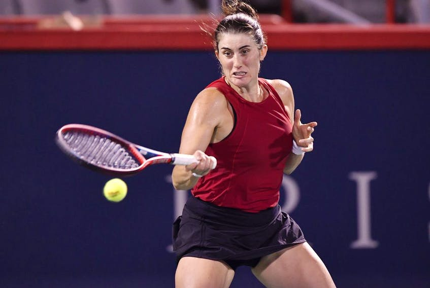 Vancouver's Rebecca Marino hits a return during her first-round match against Madison Keys of the U.S. on Day 1 of the National Bank Open at IGA Stadium on Aug. 9, 2021, in Montreal.