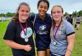 Several Cape Breton rugby players captured medals with Team Nova Scotia at the Atlantic Rugby Championships in Saint John, N.B., last weekend. Among the medallists were, from left, Destiny Romard (under-17 girls – silver medal), Annalise Robinson (under-17 girls – silver medal) and Lacey Bellefontaine (under-19 girls – gold medal). CONTRIBUTED • CHAUNTELLE BREWER