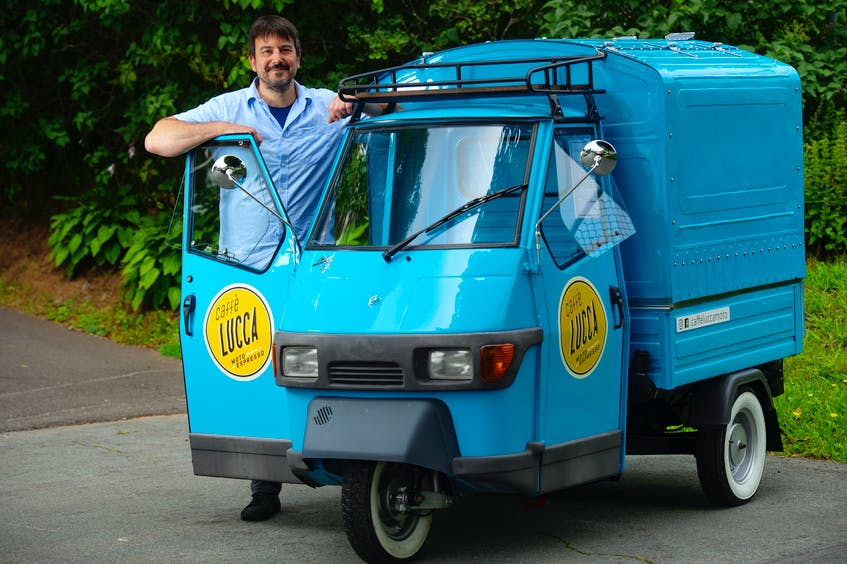 Trevor Benesch poses with his Piaggio Ape vehicle near his Dartmouth home Monday. Benesch started his Caffe Lucca Italian coffee bar business last month and will be at Shubie Park many mornings in August. - Ryan Taplin