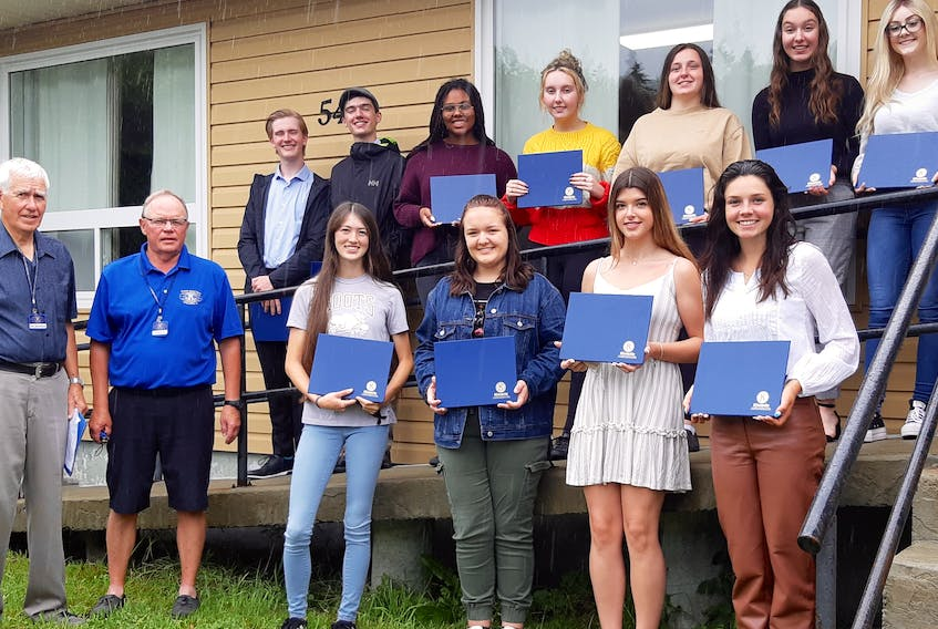 The Kiwanis of Cape Breton Golden K Club recently awarded bursaries of $1,000 each, to graduates of four local high schools, Riverview High in Coxheath, Sydney Academy, Breton Education Centre in New Waterford and Glace Bay High. Shown here are several of the 16 recipients who were honoured this year. From left, front row, Don Matheson chair of the bursary committee; club president John Ryan; Amaya Fuller (RH); Leah MacSween (RH); Meghan MacIntyre (GB) and Janelle Tierney (RH); back row, Jack Gillespie(RH); Rory Morrison(RH); Jaiden Kariuki-MacDonald (SA); Kendra MacKinnon(BEC); Brianna Budden (GB); Laura Colford (RH) and Samantha Griffen(BEC). Absent when photo was taken was Lauren H. Campbell (BEC).CONTRIBUTED