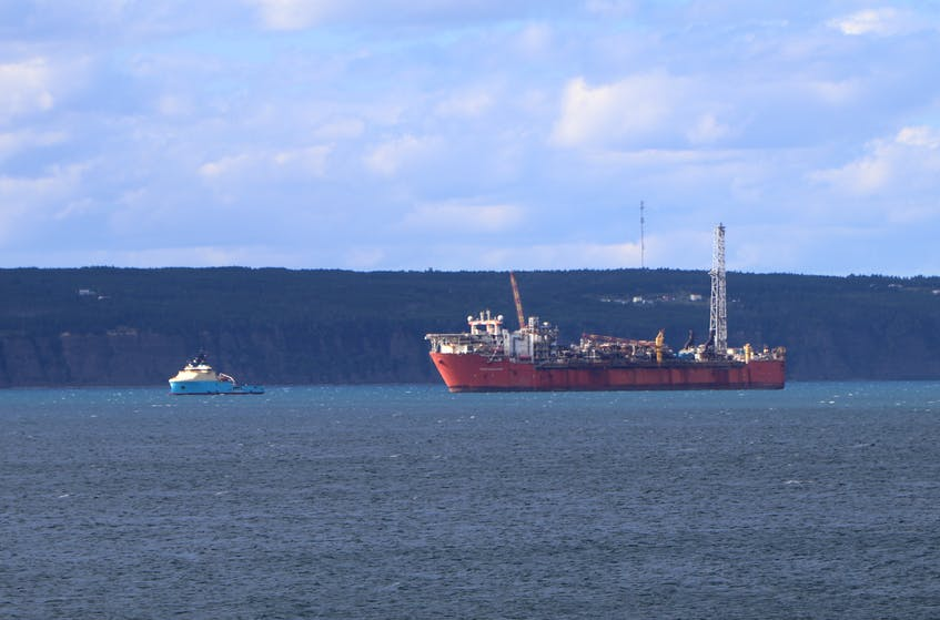The Terra Nova floating production, storage and offloading (FPSO) vessel in Conception Bay with a supply ship. — Telegram file photo