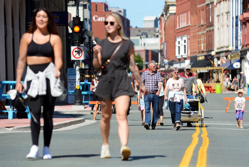 People visiting the downtown pedestrian mall in St. John's enjoy a sunny day Monday, Aug. 9. According to a United Nations report released Monday, the Earth's average temperature will increase more than 1.5 C during the next two decades. KEITH GOSSE • THE TELEGRAM