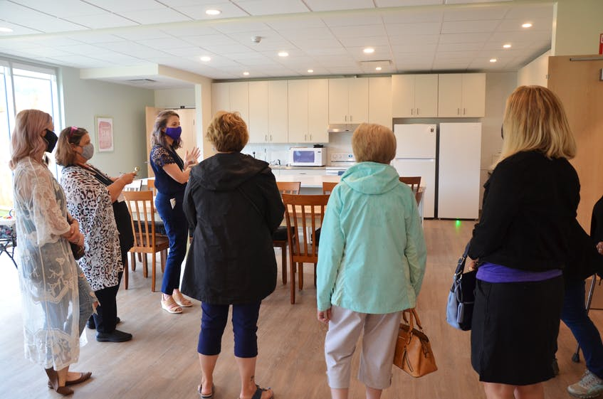 Chrysalis House executive director Ginger McPhee gives a tour of the new shelter facility at a July 30 open house event. KIRK STARRATT
