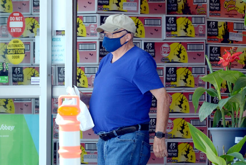 A shopper leaves Sobeys on Topsail Road Tuesday afternoon, Aug. 10, in St. John's after a mask mandate was lifted in the province. On Wednesday, the Newfoundland and Labrador government announced there were no new cases of COVID-19 and one new recovery.