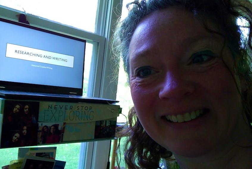 Laura Churchill Duke teaching her class virtually at home.