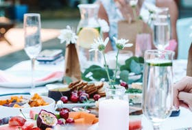 Adding colour to the summer dinner table is as easy as wildflowers and colourful food and drink.