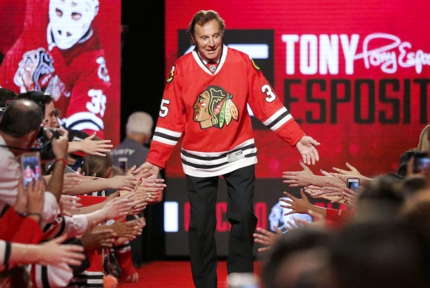 In this July 15, 2016, file photo, Blackhawks great Tony Esposito is introduced to the fans during the Blackhawks' convention in Chicago.