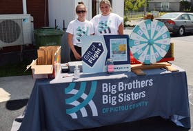 Sarah MacNeil and Sophia Wornell helped out with a raffle as part of a barbecue at the Big Brother Big Sisters of Pictou County in New Glasgow.