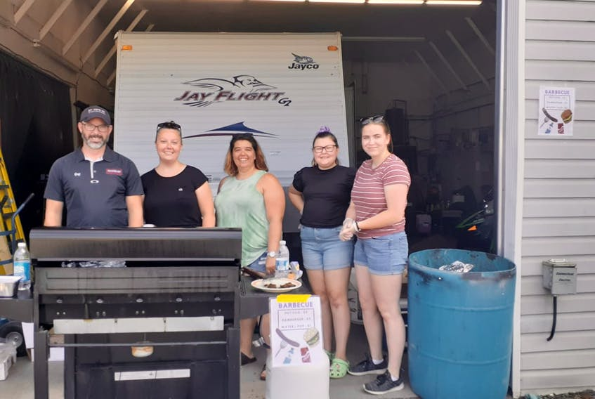 Stone's RV recently held a BBQ to raise money for Stone's RV employee Jolene MacLeod. Pictured during the event are Greg Park (left), Ashley Spaulding, Alecia Sutherland, Ashley's daughter Kendell Spaulding, and Patricia Levy.