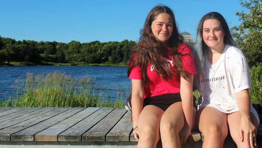 Friends Hailey Hutchings (left) and Keara Delacey get ready for a dip in Long Pond in St. John's. - Barb Sweet/The Telegram