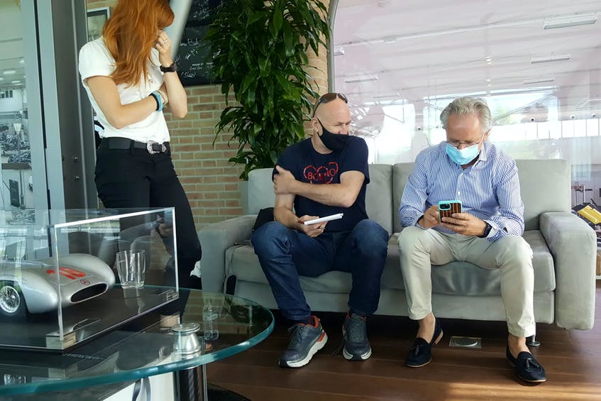 David Booth sitting with Horacio Pagani, discussing their favourite supercars. - Nadine Filion