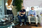 David Booth sitting with Horacio Pagani, discussing their favourite supercars. Nadine Filion/Postmedia News