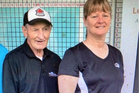Walter Gretzky with June Dobson. A charge against Dobson, 58, a commanding officer at the Ontario Provincial Police (OPP) detachment in Grenville, over the sale of a hockey stick reported to be used by Wayne Gretzky, was withdrawn, according to her lawyer.