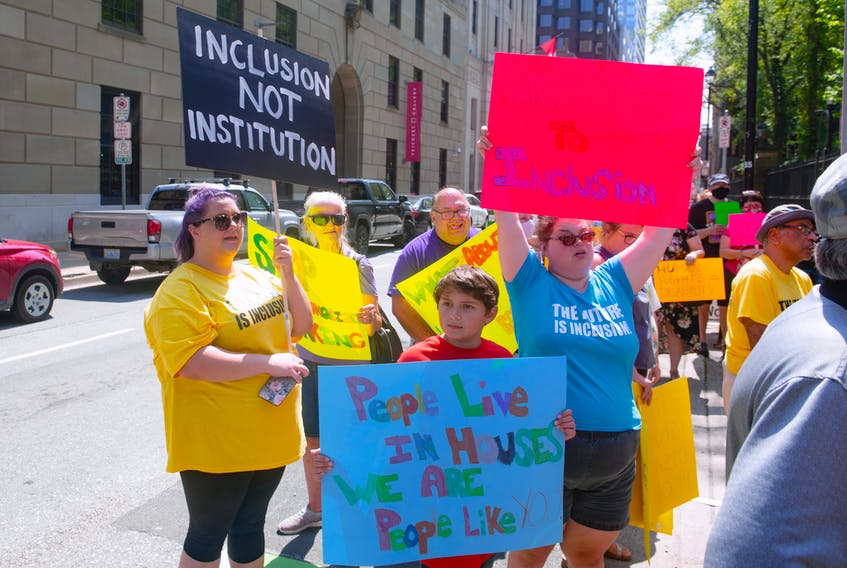 People attend a Disability Rights Coalition rally outside Province House on Friday, Aug. 13, 2021.