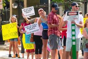 Around 150 people attended a rally against the proposed Scotiapass vaccine passport outside Province House on Friday, Aug. 13, 2021.