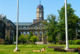 A sunbather catches some rays on the Dalhousie campus on Friday, Aug. 13, 2021.
