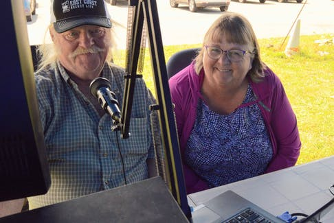 Amateur radio operator Darrell MacArthur, left, shows friend Selina Trainor how to make contact on the air at a demonstration in Summerside Aug. 8.