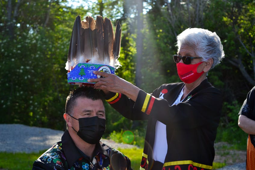 Residential school survivor Georgina Doucette struggled to heal from her childhood trauma, but found comfort in reconnecting with her culture and traditional ceremonies and is now a respected Elder in Eskasoni First Nation. She helped to bring powwows to her community in the mid-1990s and says it played a large part in the cultural resugence there. She is pictured with Chief Leroy Denny at the band chief and council inauguration in June. ARDELLE REYNOLDS • CAPE BRETON POST  - Ardelle Reynolds