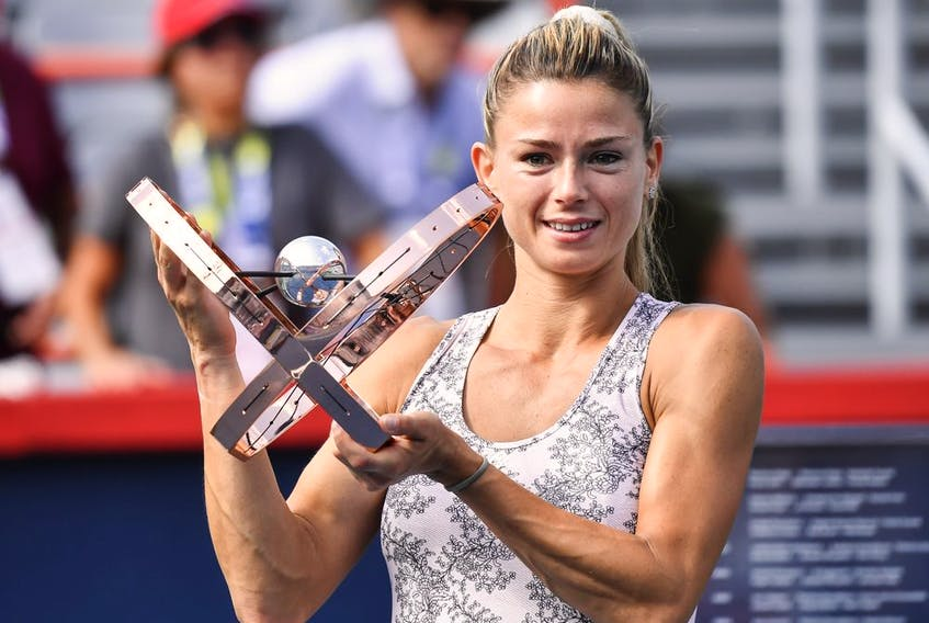 Camila Giorgi of Italy poses with the winner's trophy after defeating Karolina Pliskova of the Czech Republic during her women's singles final match on Day Seven of the National Bank Open on Aug. 15, 2021 in Montreal.