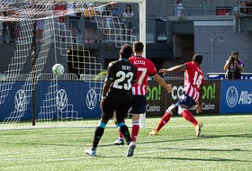 Atletico Ottawa's Brian Wright scores in the 87th minute as a dejected Cory Bent of the HFX Wanderers looks on during a Canadian Premier League match Saturday at TD Place Stadium in Ottawa. - Canadian Premier League