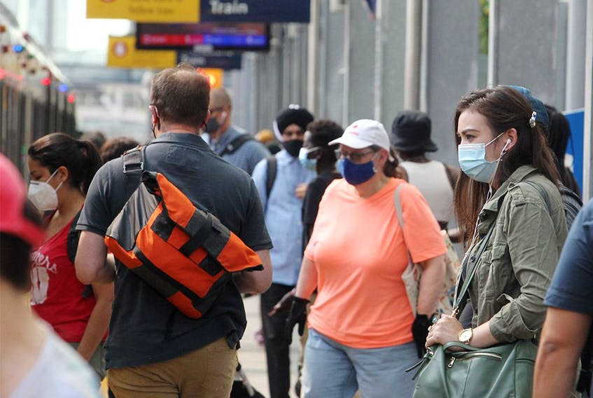 City transit users are seen wearing masks on an LRT platform downtown. Tuesday, Aug. 3, 2021.