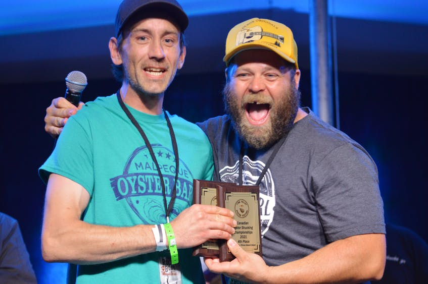 Daniel Oatway celebrates with Tyne Valley Mayor Jeff Noye after being named the fastest shucking Islander at the competition. Oatway finished in fourth place. - Kyle Reid