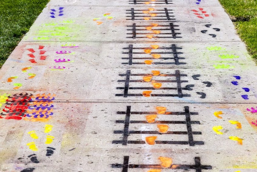 Chalk footprint decorate the sidewalks crossing through Victoria Park. Photo taken on Saturday, Aug. 14, 2021 in Regina. TROY FLEECE / Regina Leader-Post