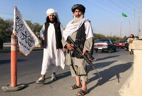 Taliban fighters stand outside the Interior Ministry in Kabul, Afghanistan, on Monday.REUTERS