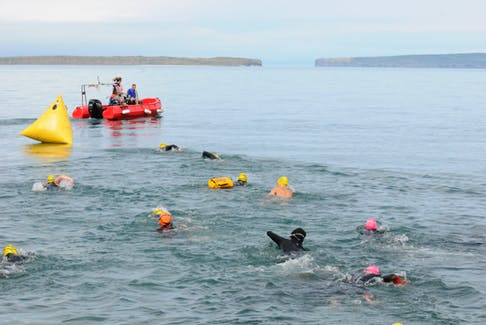 And they're off. Swimmers begin their Try The Tickle swim after leaving the shoreline at Topsail Beach on Saturday morning. -Joe Gibbons/The Telegram