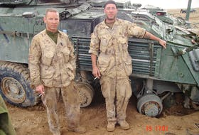 Sgt. Vaughn Igraham of Burgeo N.L. and Cpl. Christopher Reid are shown together in Afghanistan. The pair served in the same battalion and died on the same day, Aug 3, 2006.