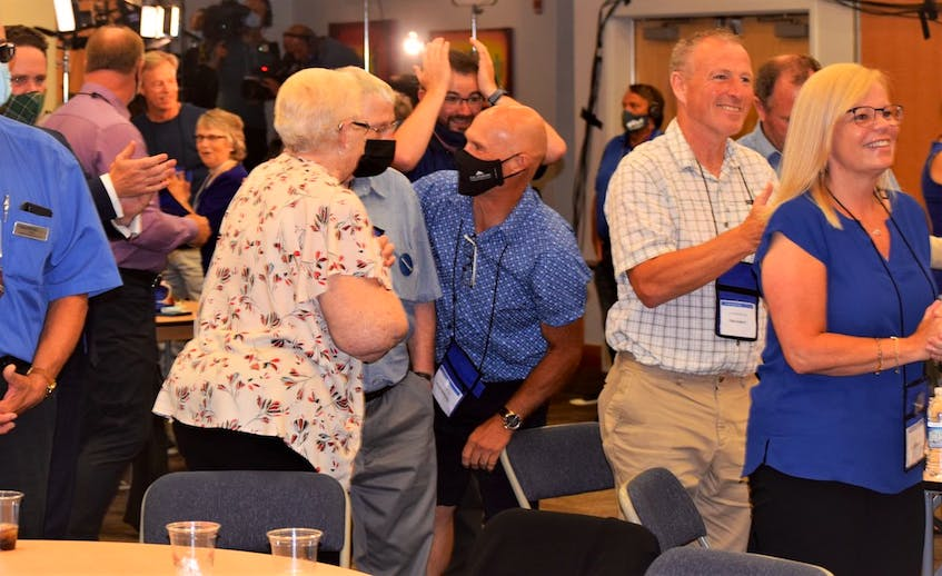Supporters at the Tim Houston election night headquarters, at the Pictou County Wellness Centre in Westville, react to the news the Progressive Conservatives were the projected winner of the 2021 Nova Scotian election, and Houston the province's next premier on Tuesday, Aug. 17, 2021. - Richard MacKenzie