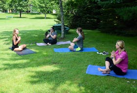 This group enjoyed a free outdoor yoga class with instructor Olivia Stevenson. Pictured facing Stevenson are Erin Sullivan, Carlie Ashton and Lisa Larson.