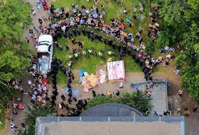 A drone image captures the lines drawn by police and protesters in front of the old Memorial Library on Spring Garden Road on Wednesday.