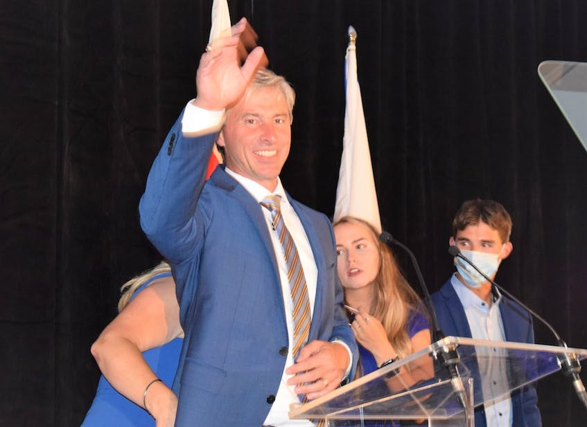 New Nova Scotia Premier Tim Houston acknowledges the cheering crowd as he settles in behind the podium for his victory speech, at the Pictou County Wellness Centre on Aug. 17, 2021. - Richard MacKenzie